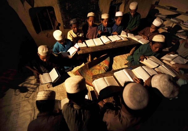 under candle light rohingya children studying to become